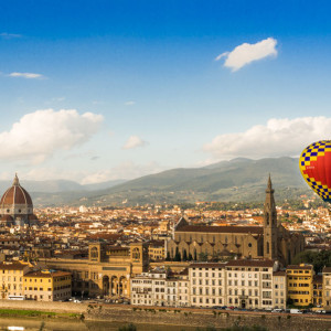 The hot air balloon drifts slowly and silently across the Florentine centre